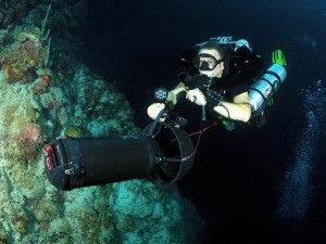 The author, with the 25W LED scuba dive light from Titan Dive Gear